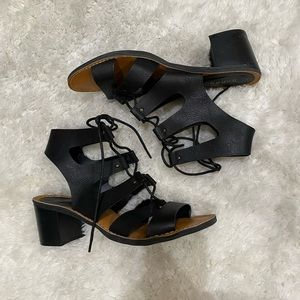 Strappy black heeled sandals